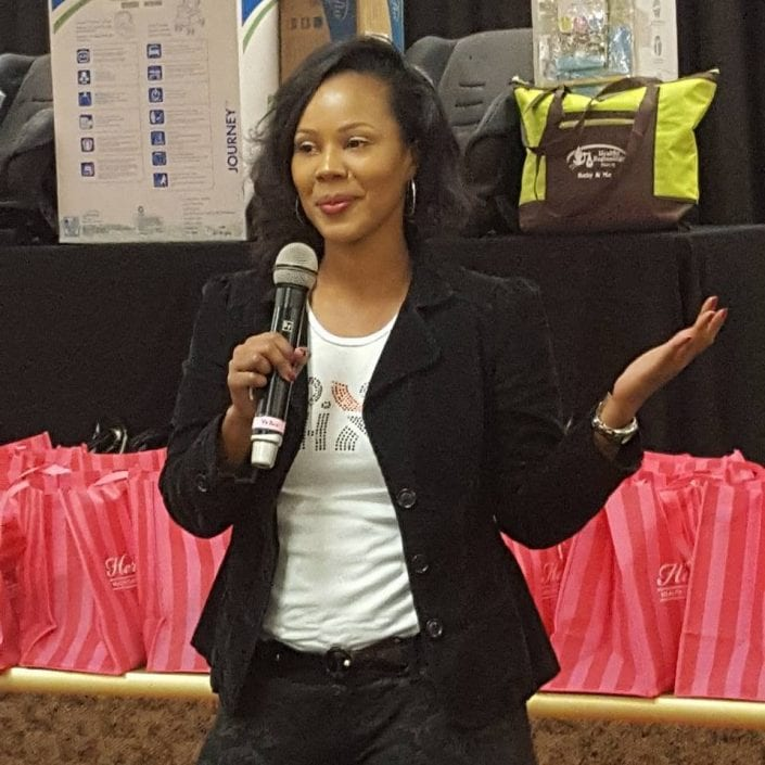 Motivational speaker and former teen mother Summer Owens speaks at a community baby shower
