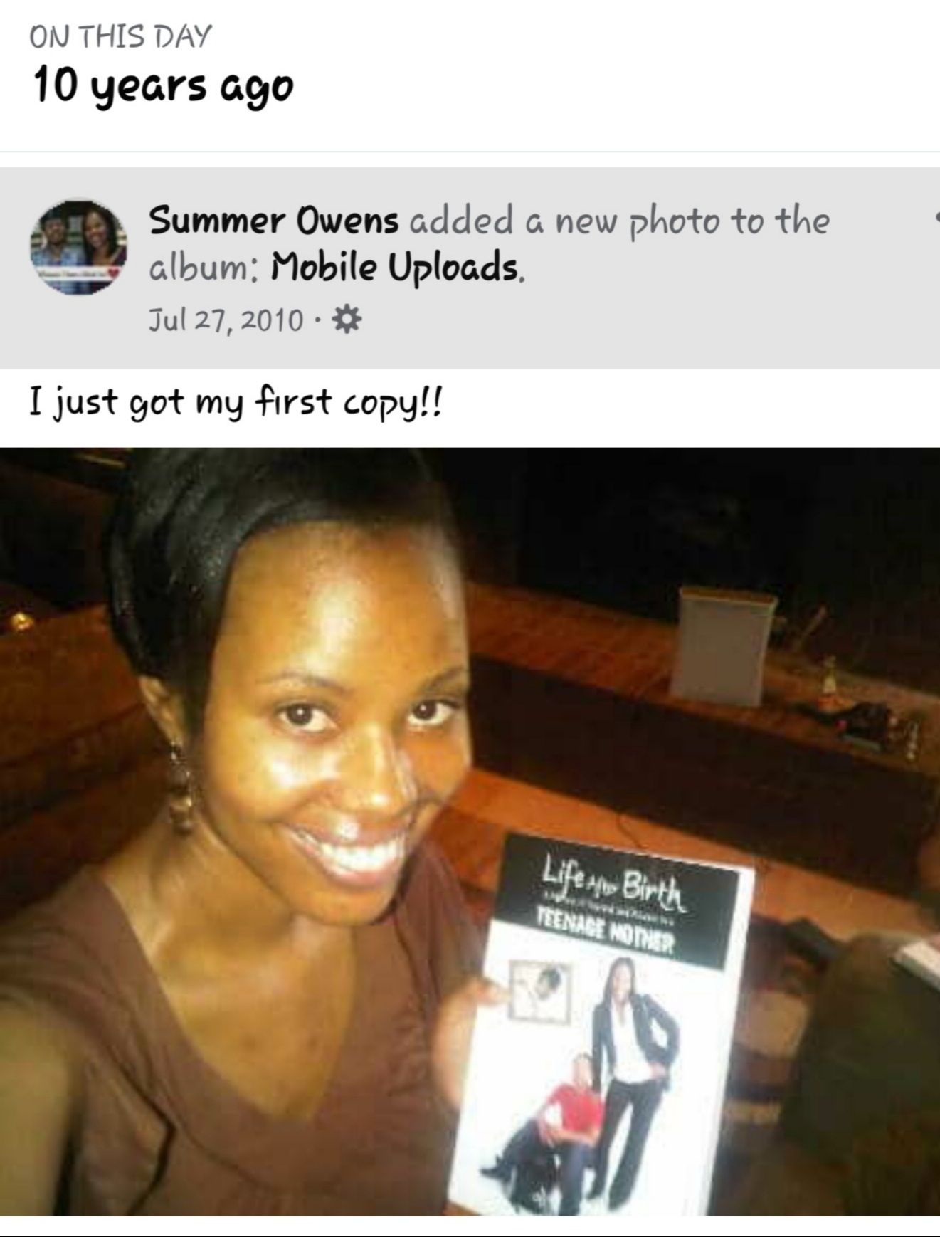 Summer Owens holding first copy of her memoir
